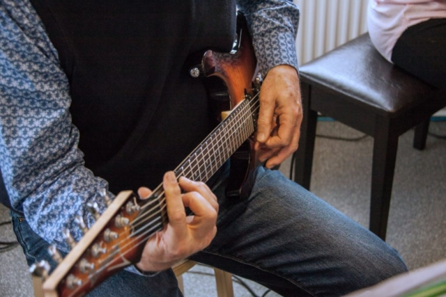 Neil plays an Ibanez Guitar